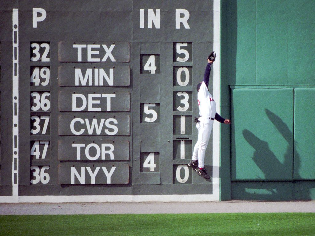 Troy O´Leary of the Red Sox makes a leaping catch in front of the Green Monster, 1999.  Click for next photo.