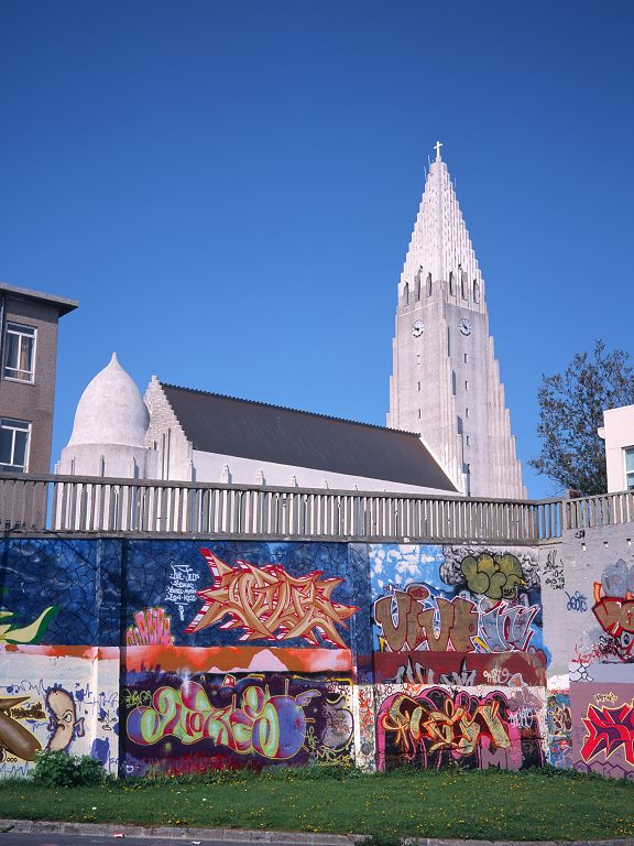 Hallgrímskirkja looms above the colorful walls of a nearby parking lot.  Click for next photo.