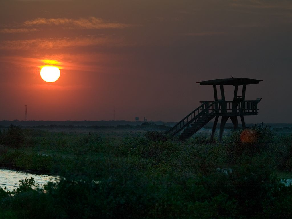 Sun sets over the observation tower at Merritt Island National Wildlife Refuge, March 2003.  Click for next photo.