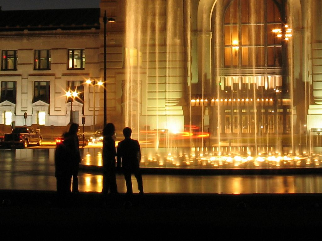 A group watches the fountain in front of Union Station, Kansas City, while waiting for a photographer (not me) to set up a shot.  Click for next photo.