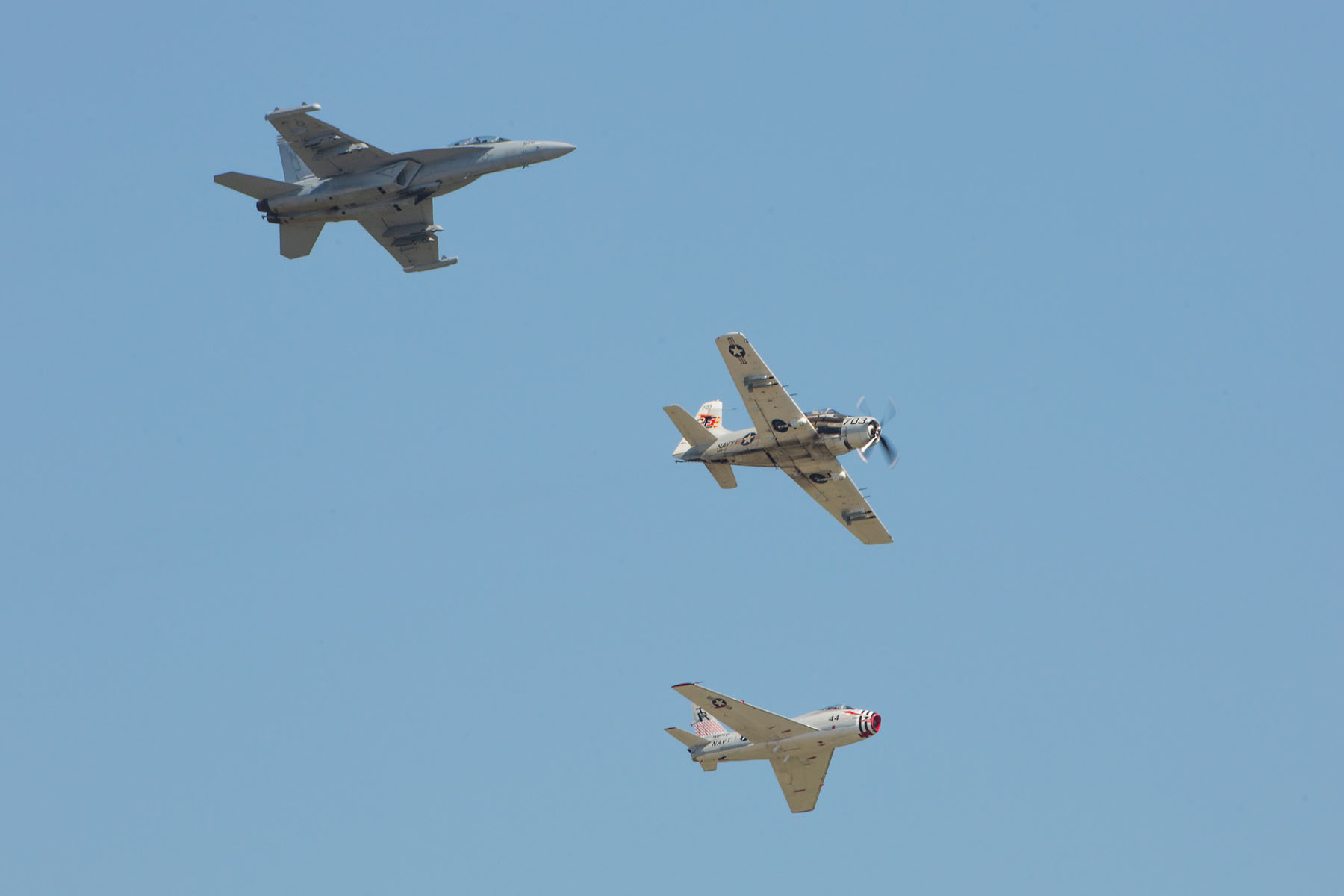 Heritage flight, Sioux Falls Air Show, August 2019.  The flight featured Navy planes (from top) F/A-18 Hornet, AD-4 Skyraider, and FJ-4B Fury.  Click for next photo.
