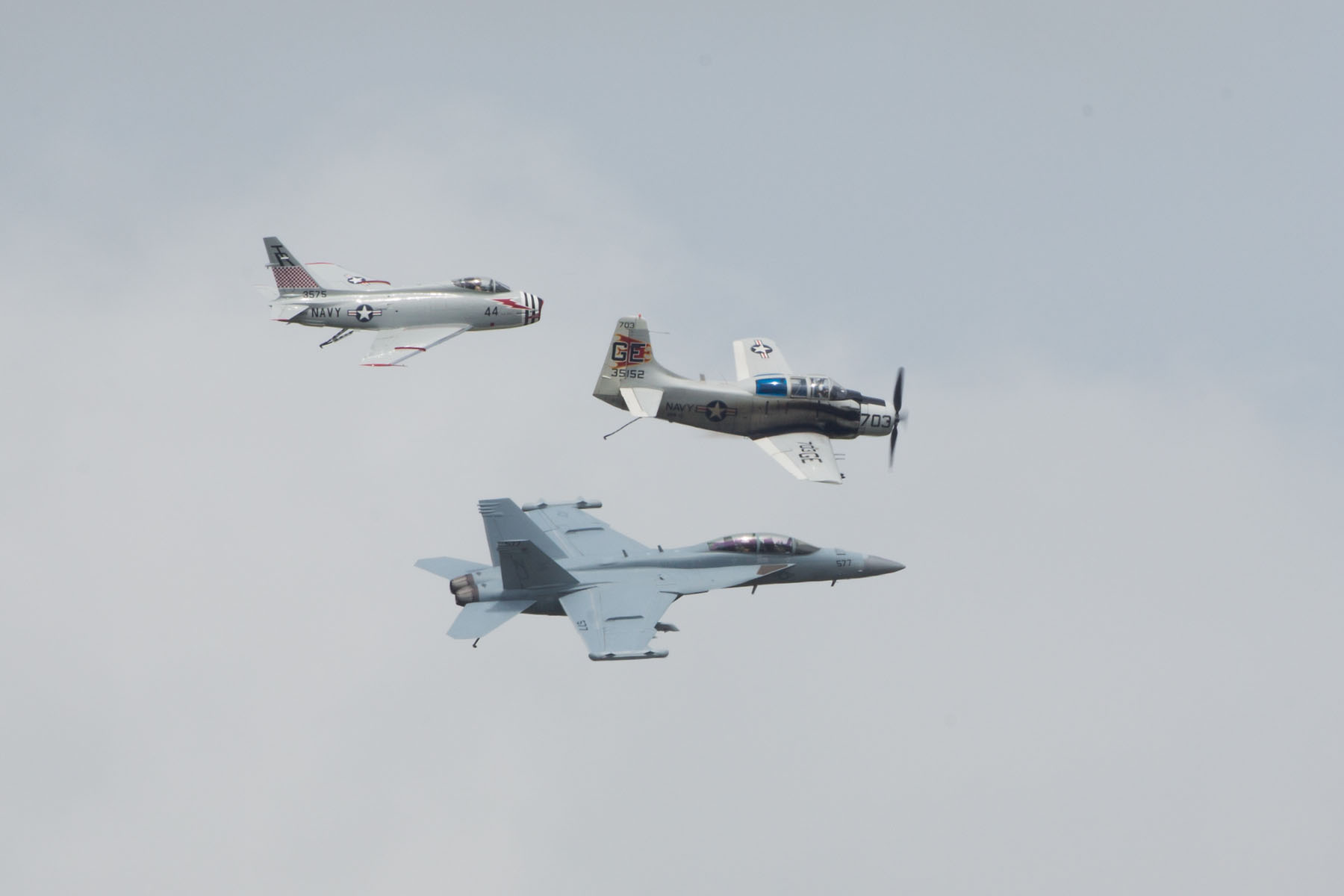Heritage flight, Sioux Falls Air Show, August 2019.  The flight featured Navy planes (from top) FJ-4B Fury, AD-4 Skyraider, and F/A-18 Hornet.  Click for next photo.